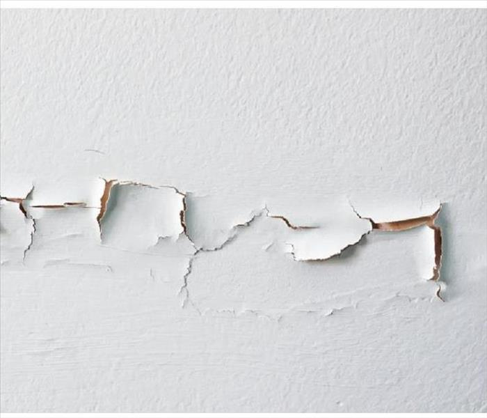 White wall with torn drywall